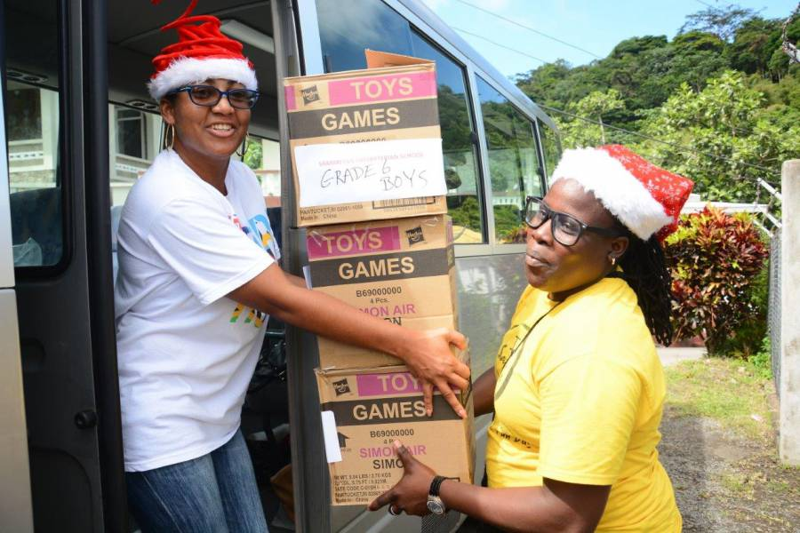 Sandals Foundation Volunteers Delivering Gifts